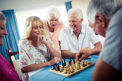Group of seniors playing chess Stock Photos