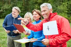 Group of seniors at scavenger hunt as a game of terrain. Active group of seniors at scavenger hunt as a game in nature royalty free stock photography