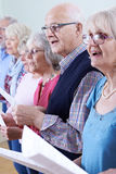Group Of Seniors Singing In Choir Together. Group Of Seniors Singing In Choir Stock Photography