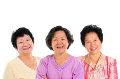 Group of seniors. Three Asian senior women smiling happily isolated on white background Royalty Free Stock Photography