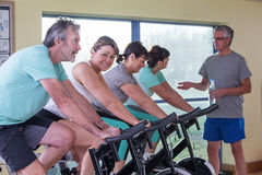Group of seniors using spinning bikes Royalty Free Stock Photo