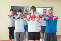 Group of seniors with weights Stock Photo