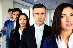 Group of a serious business people Stock Photos