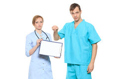 Group serious doctors presenting empty board Stock Images