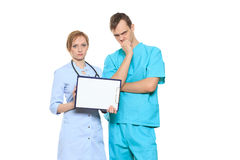 Group serious doctors presenting empty board Stock Image
