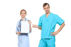 Group serious doctors presenting empty board Royalty Free Stock Image