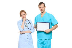 Group serious doctors presenting empty board Stock Photo