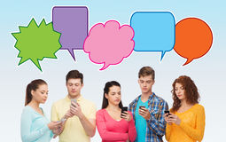 Group of serious teenagers with smartphones Royalty Free Stock Images