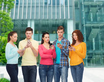 Group of serious teenagers with smartphones Royalty Free Stock Photography