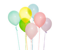 Group of seven balloons isolated. In different colors: pink, yellow, green, blue, purple, pastel colors Stock Photos