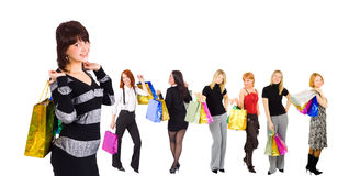 Group of seven shopping girls Stock Photos