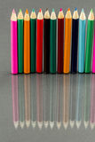Group of sharp colored pencils with reflexions Royalty Free Stock Photography