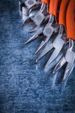 Group of sharp insulated electric gripping tongs nippers vertical Royalty Free Stock Images