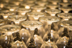 Group of Shiny Wine Glass Stems. Group of shining wine glass stems in circular patterns Royalty Free Stock Photo