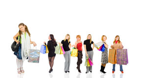 Group of shoppers with little girl Stock Photos