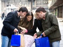 Group shopping. Group of young friends doing shopping stock photos