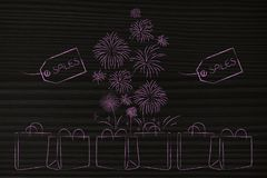 Group of shopping bags with Sales price tags and fireworks comin Stock Photos