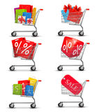 Group of shopping carts full of shopping bags and  Stock Photos