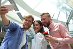 Group shot of colleagues having fun in their office. royalty free stock images