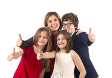 Group shot of a family with thumbs up isolated Stock Photo