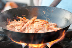 Shrimp in the frying pan on fire Stock Image