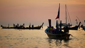 Group of silhouette long tail boat convertedfloating in the andaman sea with golden light of the Sun. Group of silhouette long tail boat converted to boat stock video footage