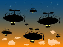 Group of Silhouetted Airship Sail High dusky sky Royalty Free Stock Photos
