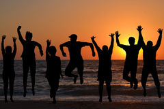 Group of silhouettes of people jumping Stock Image