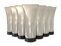 Group of silver tube packs with black caps Royalty Free Stock Images
