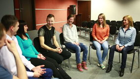 Group sits in a circle. They tell their stories. psychological relief. stock footage