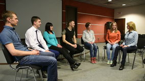 Group sits in a circle. They tell their stories. psychological relief. stock video footage