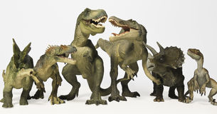 A Group of Six Dinosaurs in a Row. A Group of Six Ferocious Dinosaurs Lined Up in a Row Against White Stock Photography