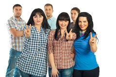 Group of six friends. With three women in front showing victory sign hand gesture isolated on white background Stock Images