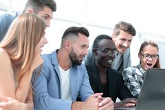 Multiracial designers are smiling. Group of six multi generation of creative use technology together of smartphone, table and laptop, internet lifestyle royalty free stock image