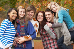 Group Of Six Teenage Friends Having Fun. In Autumn Park Royalty Free Stock Photography