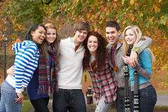 Group Of Six Teenage Friends Having Fun. In Autumn Park Stock Photography