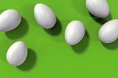 Group of six white eggs on green background stock images