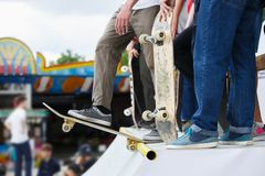 Group of skater boys compete in skate contest outdoor Stock Photo