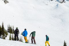 A group of skiers on Blackcomb, 7th Heaven, on a sunny day. royalty free stock images