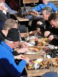 A group of skiers have a leisurely lunch outdoors Stock Images
