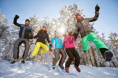 Group of skiers in jump. Group of young skiers in jump on snow stock photo