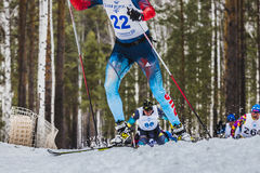 Group of skiers male athletes up mountain. Kyshtym, Russia -  March 26, 2016: group of skiers male athletes up mountain during Championship on cross country Royalty Free Stock Images