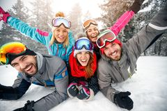 Group of skiers enjoying together on snow in mountain. Group of skiers male and female enjoying together on snow in mountain Stock Image