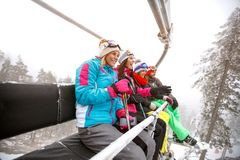 Group of skiers in ski lift on mountain royalty free stock images