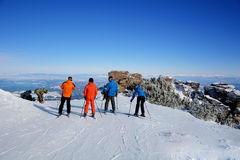 A group of skiers  on a slope in the winter mountain Royalty Free Stock Images