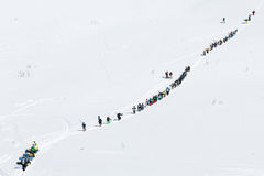 Group of skiers and snowboarders climbing the mountain for freeride. KAMCHATKA PENINSULA, RUSSIAN FEDERATION - MARCH 9, 2014: Group of sportsmens - skiers and Stock Photo
