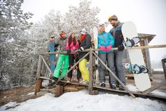 Group of skiers together talking. Group of young skiers together talking and having fun Stock Photography