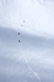 Skiers on the glacier in Alps. A group of skiers wandering across a glacier in Austrian Alps royalty free stock images
