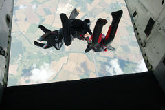 Group of skydivers exit an airplane. As a formation Stock Photography