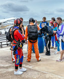Group of skydivers prepaire to skydive. Royalty Free Stock Photo